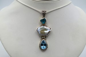 Baroque pearl pendant with apatite crystal and faceted blue topaz