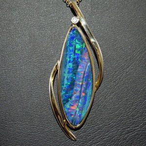 Boulder opal and diamond 14K gold pendant