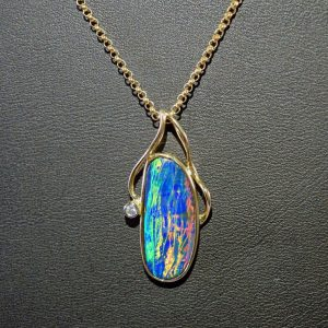 Boulder opal and diamond 14K gold pendant