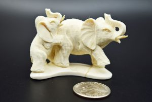 Elephants carved from fossil ivory