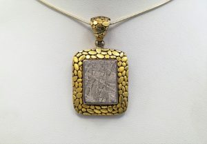 Gibeon meteorite with 18K gold pendant