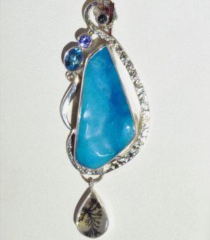 Hemimorphite, dendritic agate, blue topaz, and tanzanite pendant