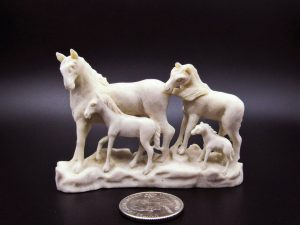 Horse family carving from moose antler