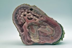 Rhodochrosite house scene carving