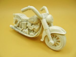 Motorcycle carved from moose antler