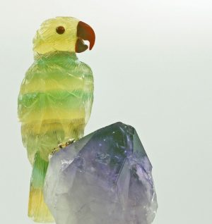 Fluorite parrot on amethyst