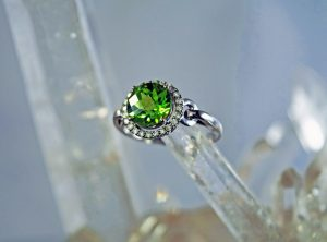 Peridot and diamond 8mm round halo 14K white gold ring