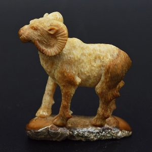Ram carved from fossil ivory
