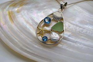 Sea glass, starfish, and blue topaz pendant
