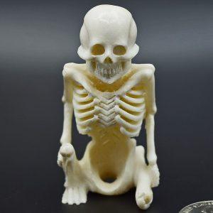 Sitting skeleton carved from moose antler
