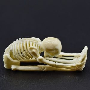 Stretching skeleton carved from fossil ivory