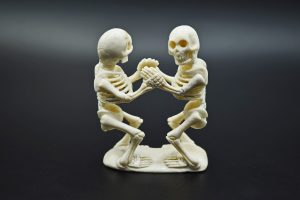 Two skeletons dancing carved from moose antler