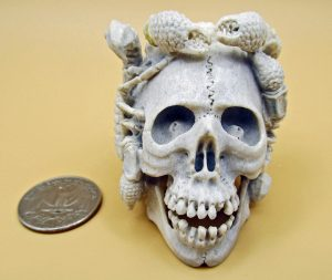 Skull with three scorpions carved from moose antler