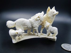 Wolf family carved from moose antler