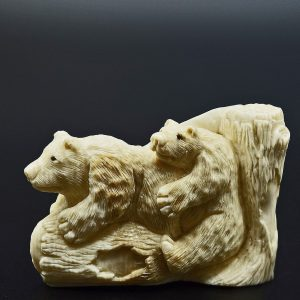 Bears on a log carved from fossil ivory