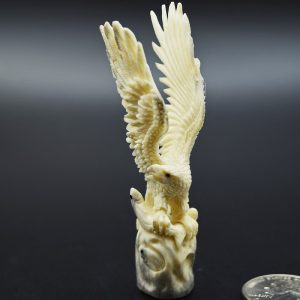 Eagle with fish carved from moose antler