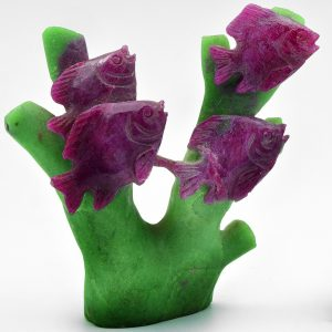 Four fish on coral carved from ruby in zoisite