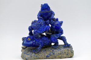 Four lapis frogs on quartz