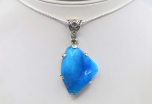 Hemimorphite with blue topaz pendant