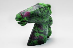 Horse head carved from ruby in zoisite