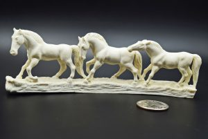 Horses carved from moose antler