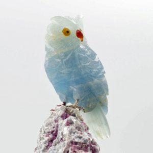 Blue calcite owl on pink tourmaline quartz