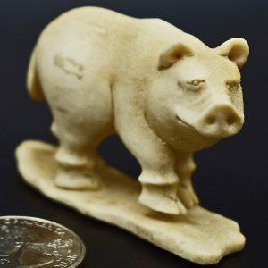 Pig carved from moose antler