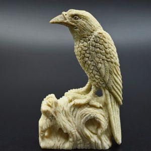 Raven carved from moose antler