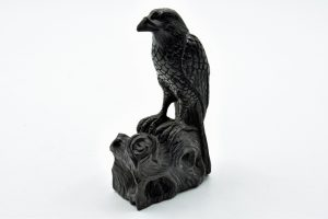 Jet perched raven carving
