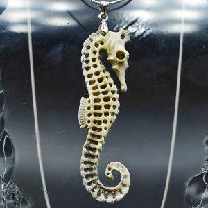Skeletal seahorse carved from moose antler pendant