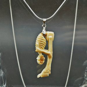 Skeleton stretching pendant carved from fossil ivory