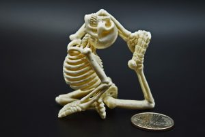 Yoga skeleton carved from moose antler