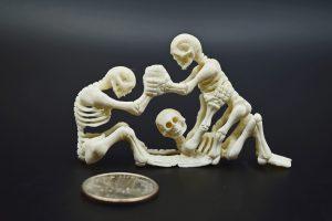 Three skeletons carved from moose antler