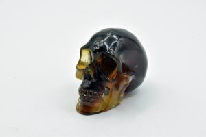 Blue-amber skull carving
