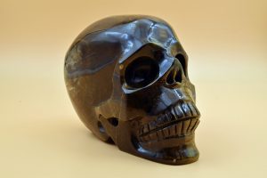 Blue and yellow tiger's eye skull carving