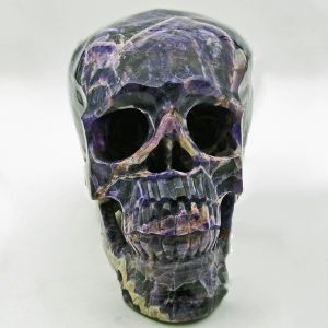Large chevron amethyst skull carving