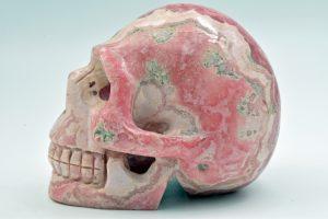 Rhodochrosite skull carving