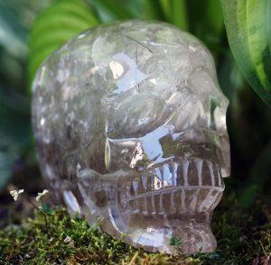 Smoky quartz with black rutile and rainbows skull