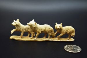 Wolves carved from fossil ivory